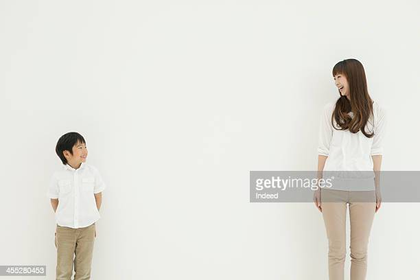 Mother and son look at each other