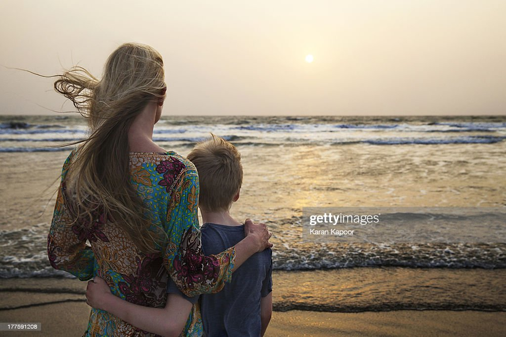 Mother and Son looking at sunset : Stock Photo