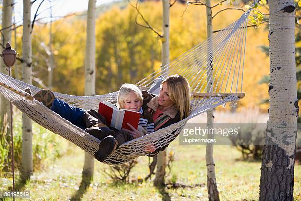Mother and son lounging in a hammock