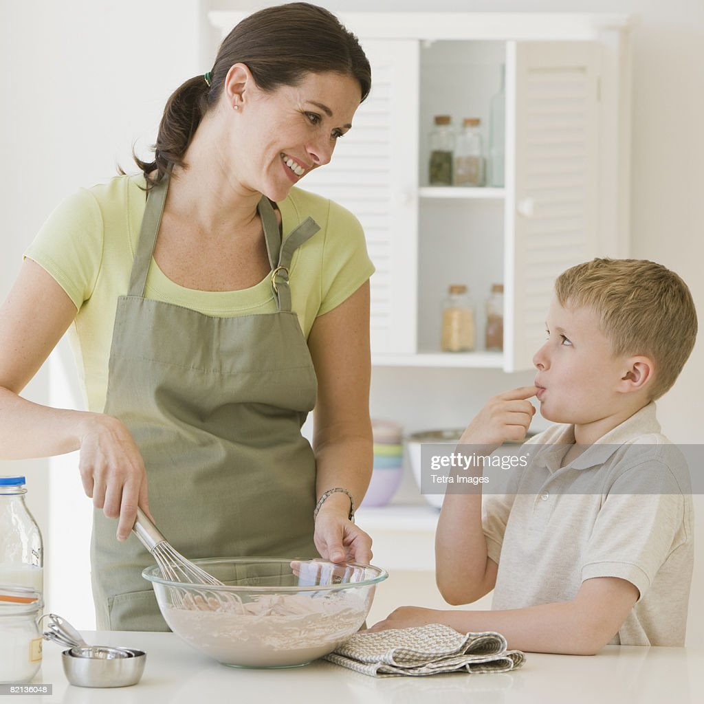 Mother and son making batter : Stock Photo
