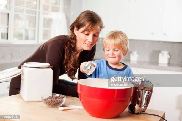 A mother and son making chocolate chip cookies together