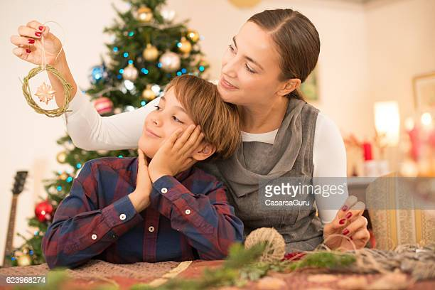 Mother and Son Making Christmas Decoration