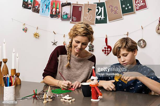 Mother and son making X mas decorations