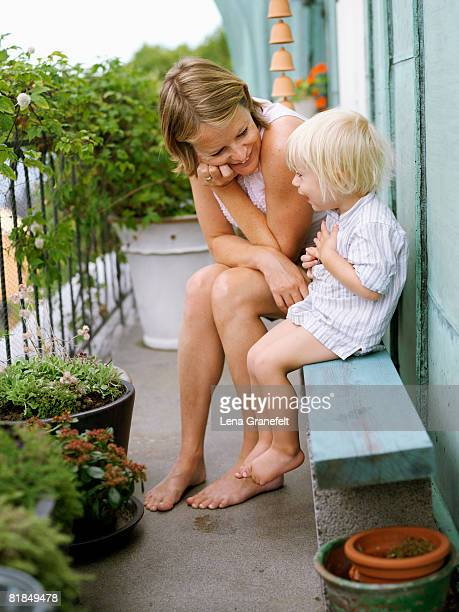 Mother and son on a balcony Sweden.