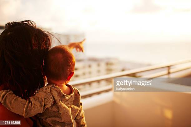 Mother and son on balcony