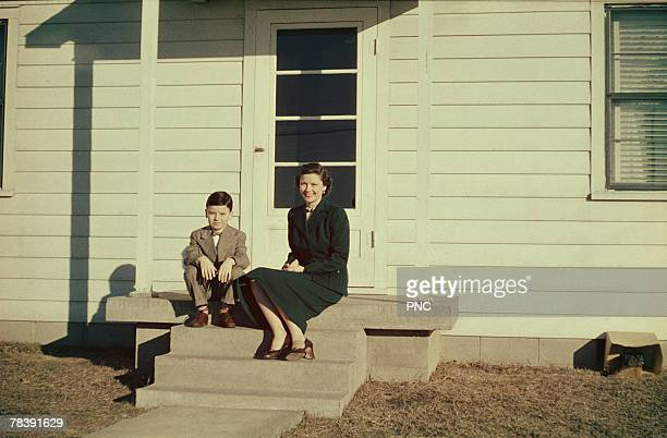 Mother and son on porch
