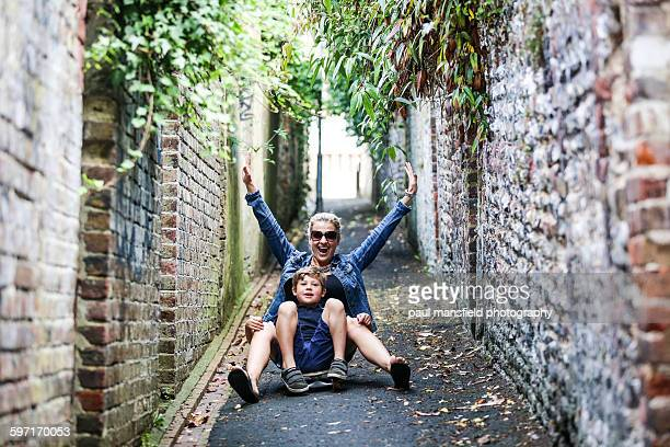 Mother and son on skateboard
