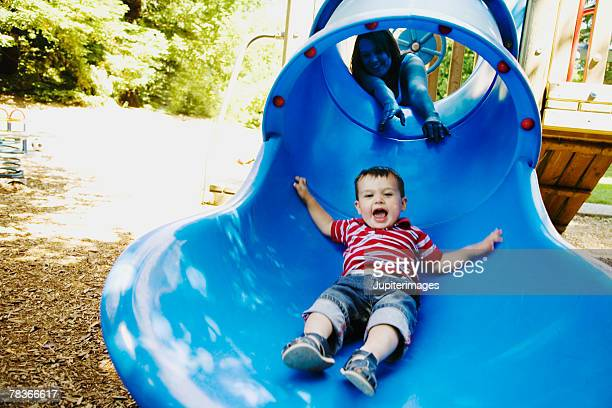 Mother and son on slide