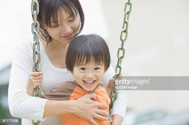 Mother and son on swing
