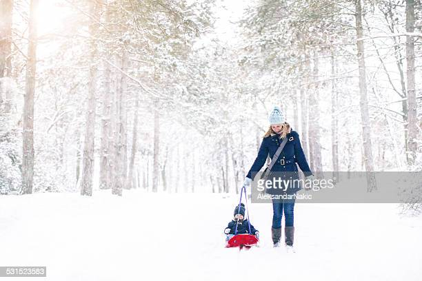 Mother and son on the snow