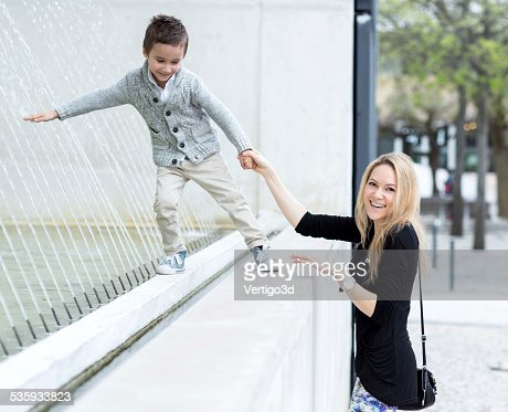Mother and son on the street : Stock Photo