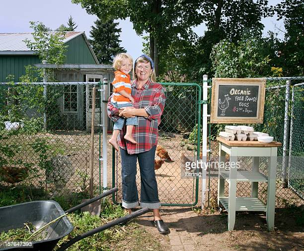 Mother and son outside their free range chicken coop