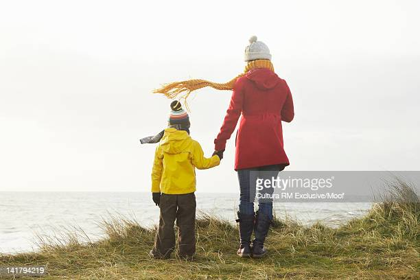 Mother and son overlooking coastline