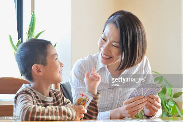 Mother and son playing card game together