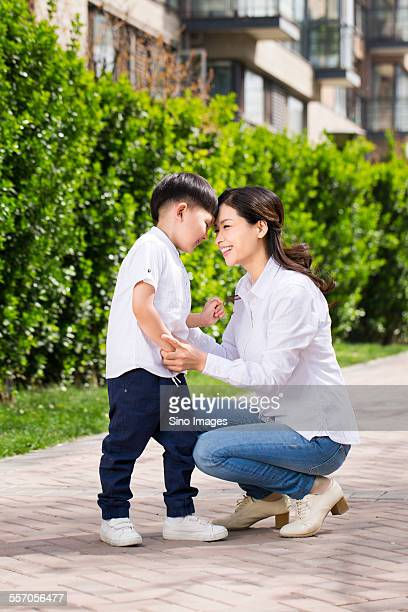Mother and Son Playing Games Outdoors