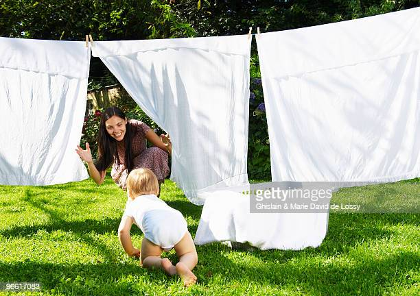 Mother and son playing in the laundry