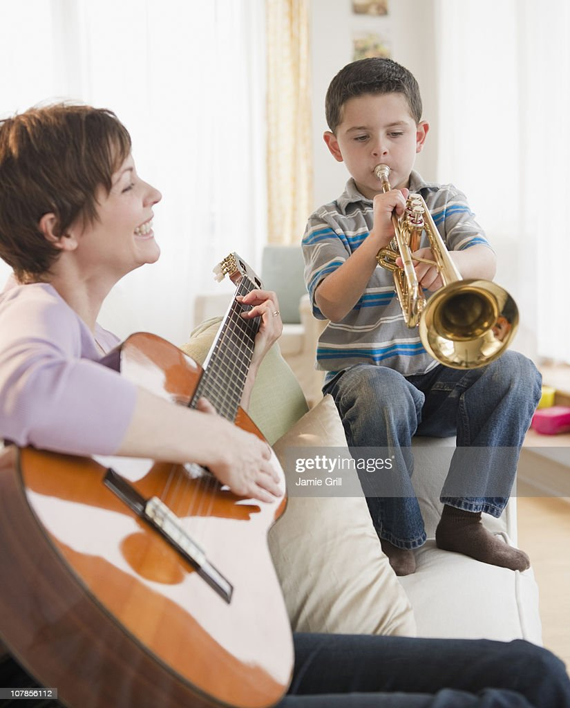 Mother and son playing insturments together : Stock Photo