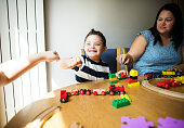 Mother and son playing together at a table