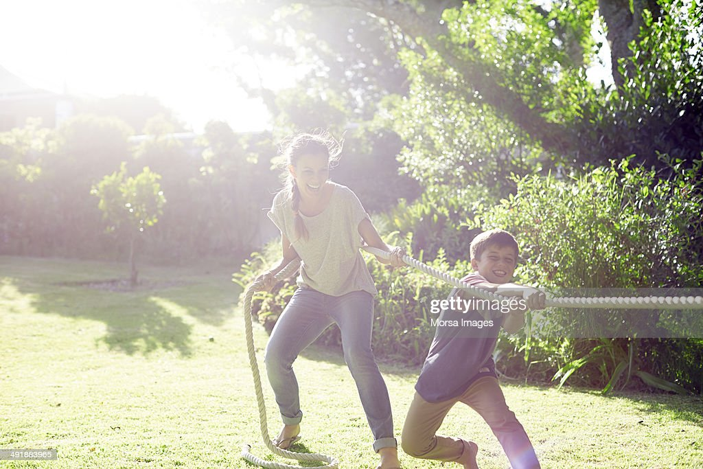 Mother and son playing tug-of-war : Stock Photo
