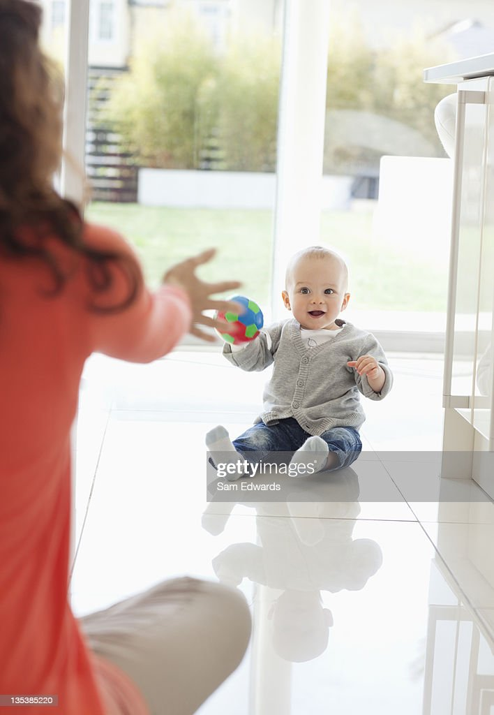 Mother and son playing with ball : Stock Photo