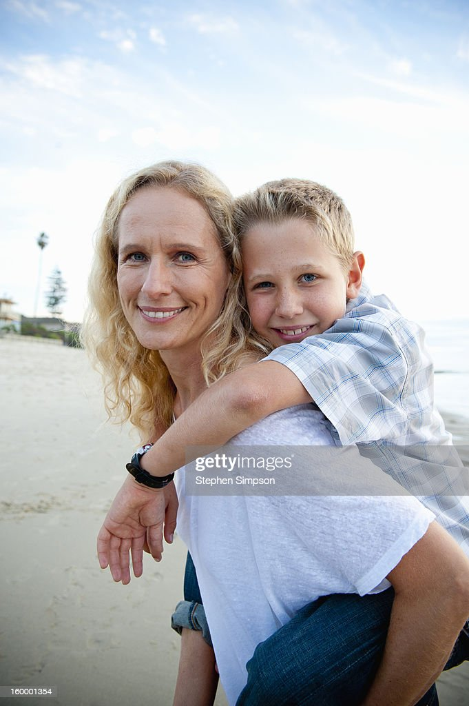mother and son portrait at the beach : Stock Photo
