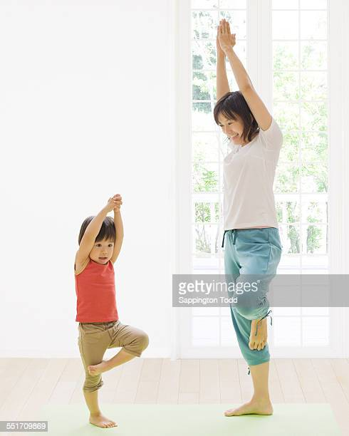 Mother And Son Practicing Yoga
