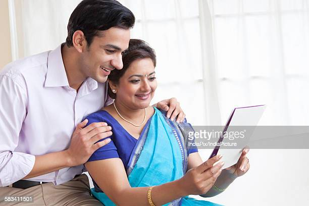 Mother and son reading a greeting card