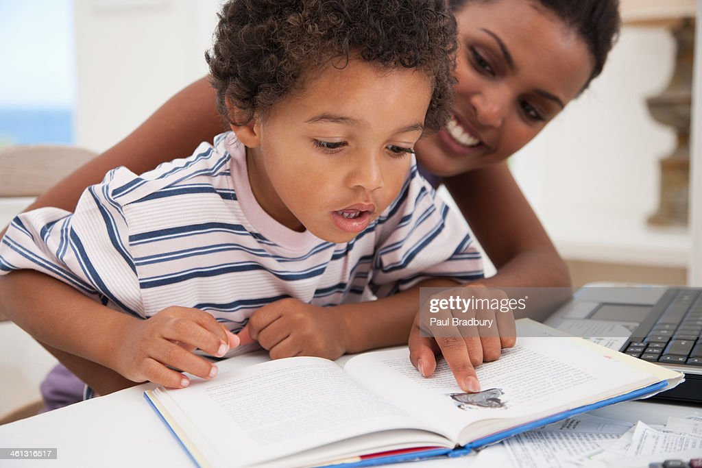 Mother and son reading : Stock Photo