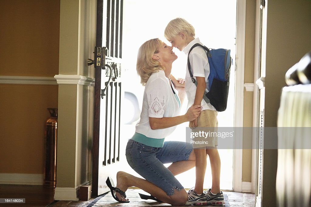 Mother And Son Rubbing Noses At Front Door
