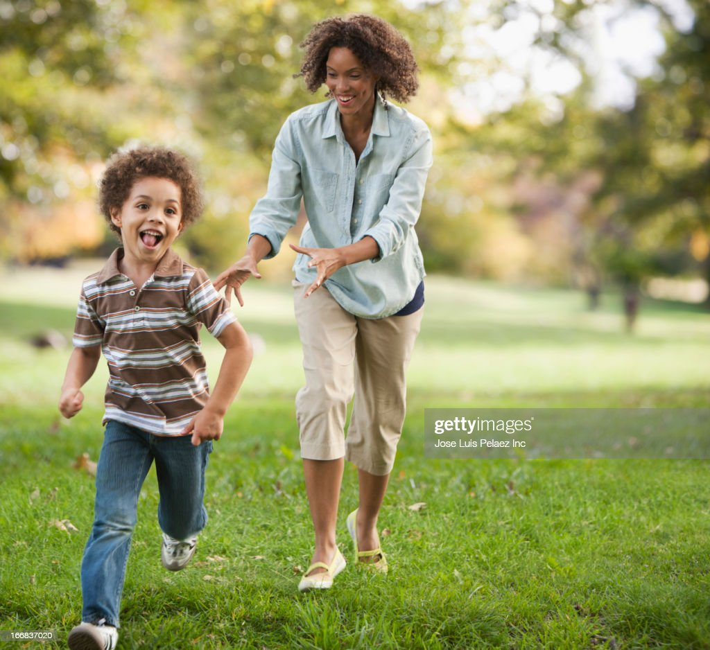 Mother and son running in park : Stock Photo