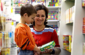 Mother and son shopping for educational materials