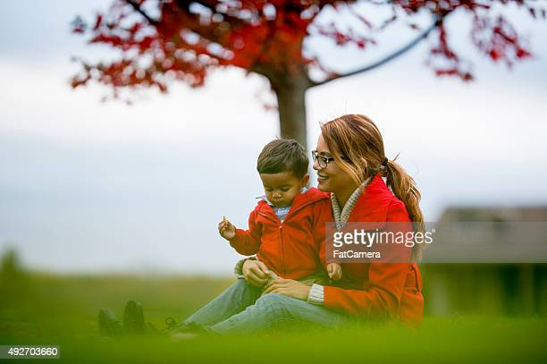 Mother and Son Sitting Together Outside