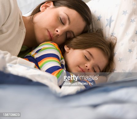 mother and son sleeping in bed stock photo getty images. Black Bedroom Furniture Sets. Home Design Ideas