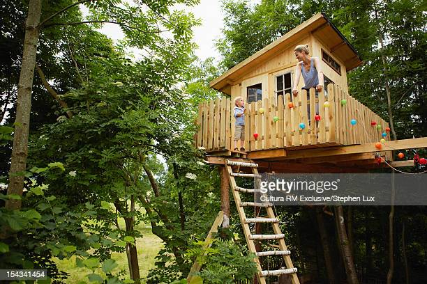 Mother and son talking in treehouse