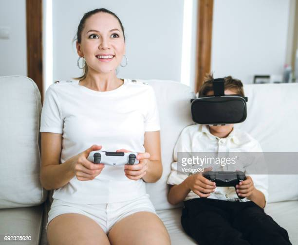 Mother and son testing Virtual Reality simulator at home