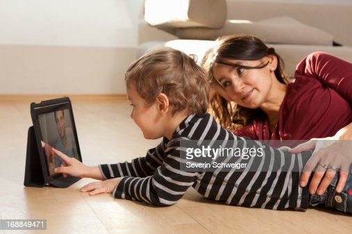 Mother and son video chatting : Stock Photo