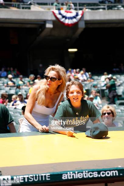 A mother and son wait to get autographs prior to the game between the Oakland Athletics and the Toronto Blue Jays at Oco Coliseum on July 6 2014 in...