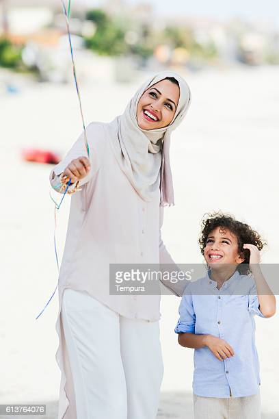 Mother and son walking in Dubai.