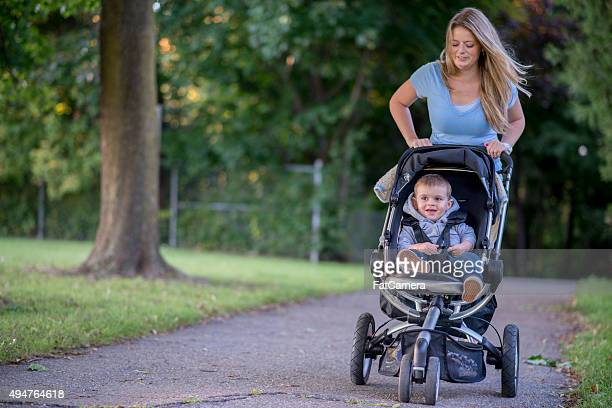 Mother and Son Walking Through the Park Together