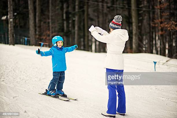Mother and son warming up before skiing lesson