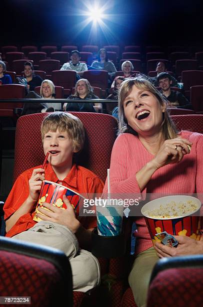 Mother and Son Watching a Movie in the Theater