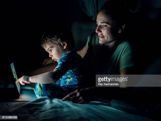 Mother and son watching tablet