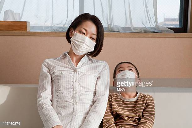 Mother and son wearing mask