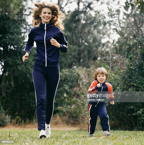 Mother and son wearing tracksuits jogging