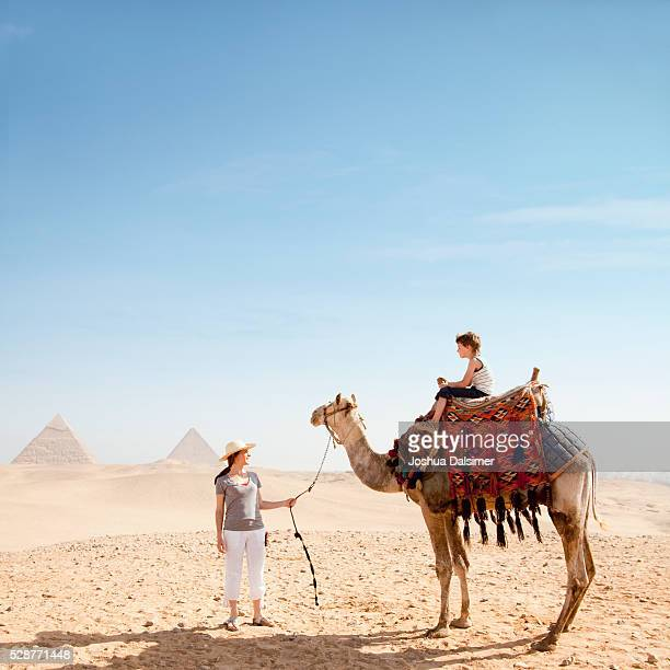 Mother and son with a camel