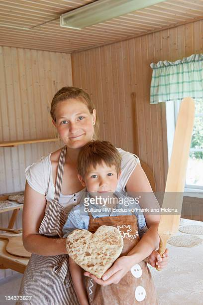 Mother and son with heart-shaped bread