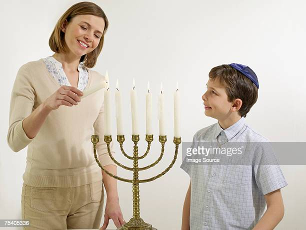 Mother and son with menorah