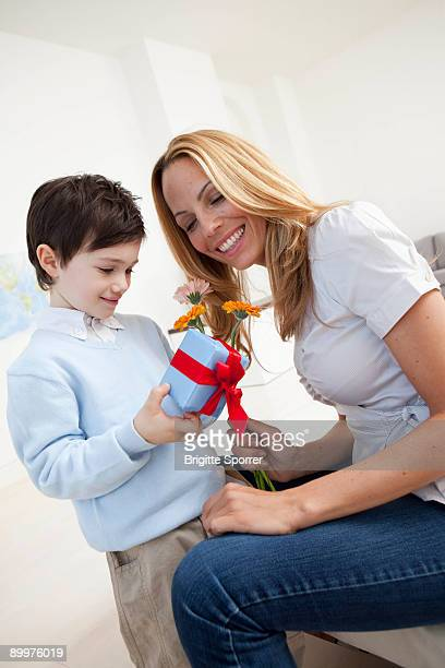 mother and son with present