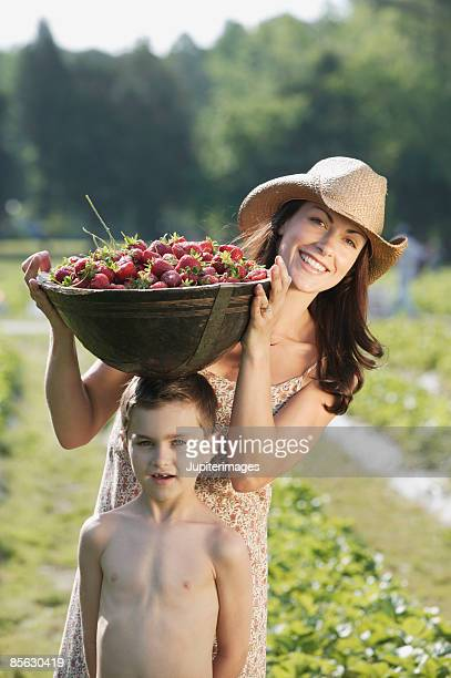 Mother and son with strawberries