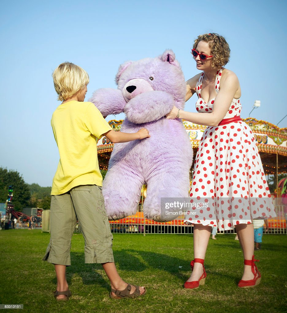 Mother And Son With Teddy Bear At Fair Stock Photo